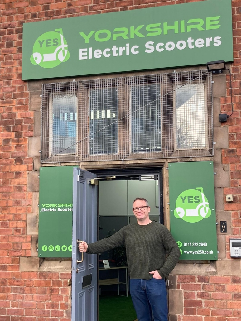 Gordon Riley outside Yorkshire Electric Scooters